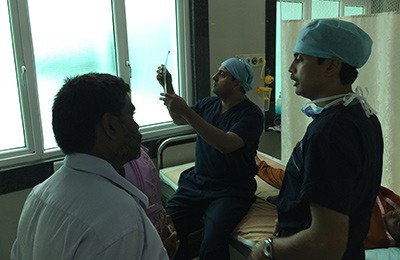 Dr Hosalkar examining patients with Dr Rajkumar at Ganga Hospital, Coimbatore.