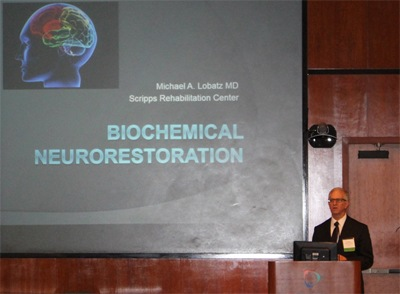 Dr Michael Lobatz delivering his talk at the Neuro-Restorative Care Conference