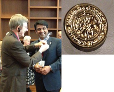 Dr Hosalkar receiving the Presidential Pin